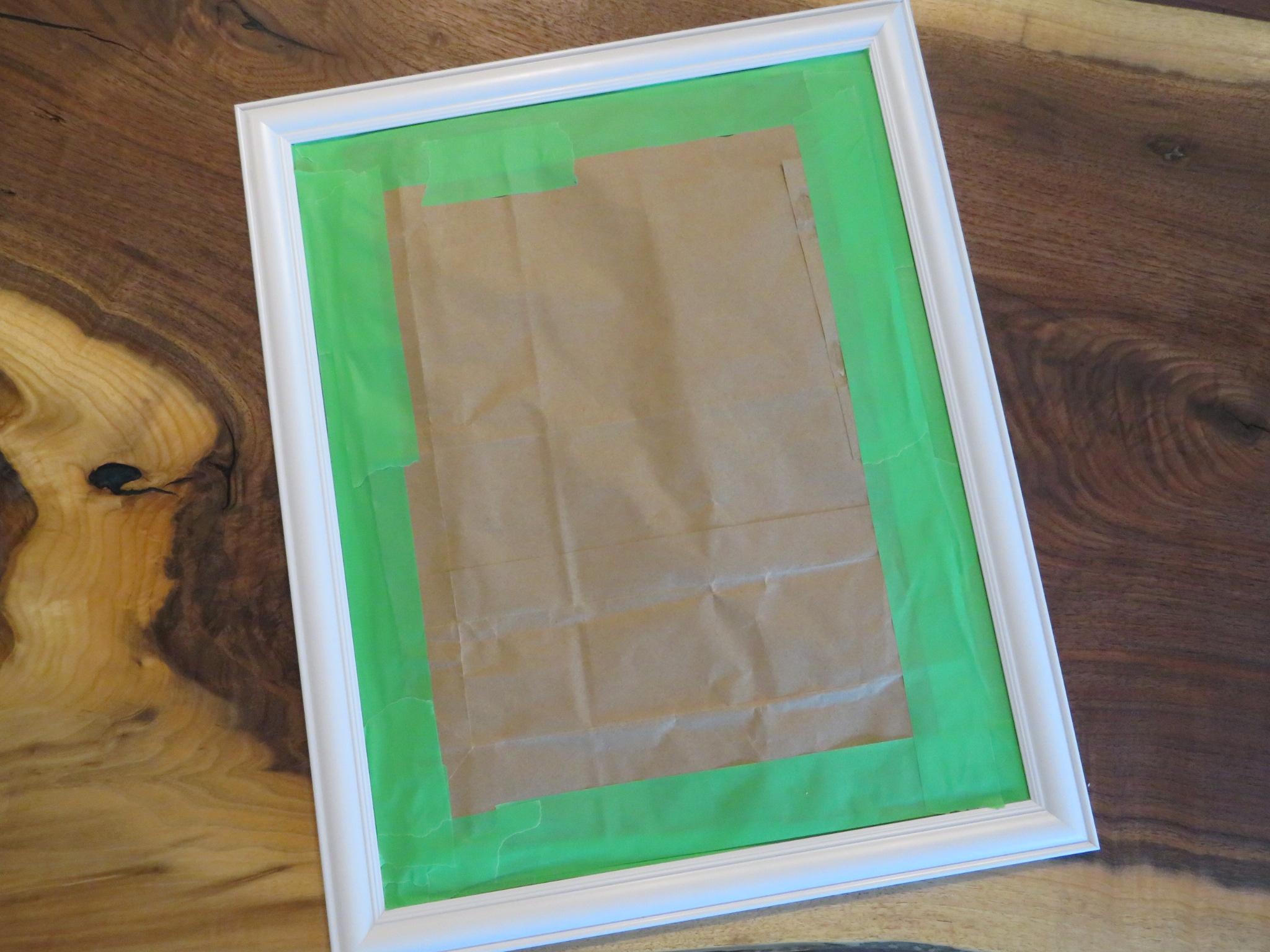 White mirror frame prepared for spray paing