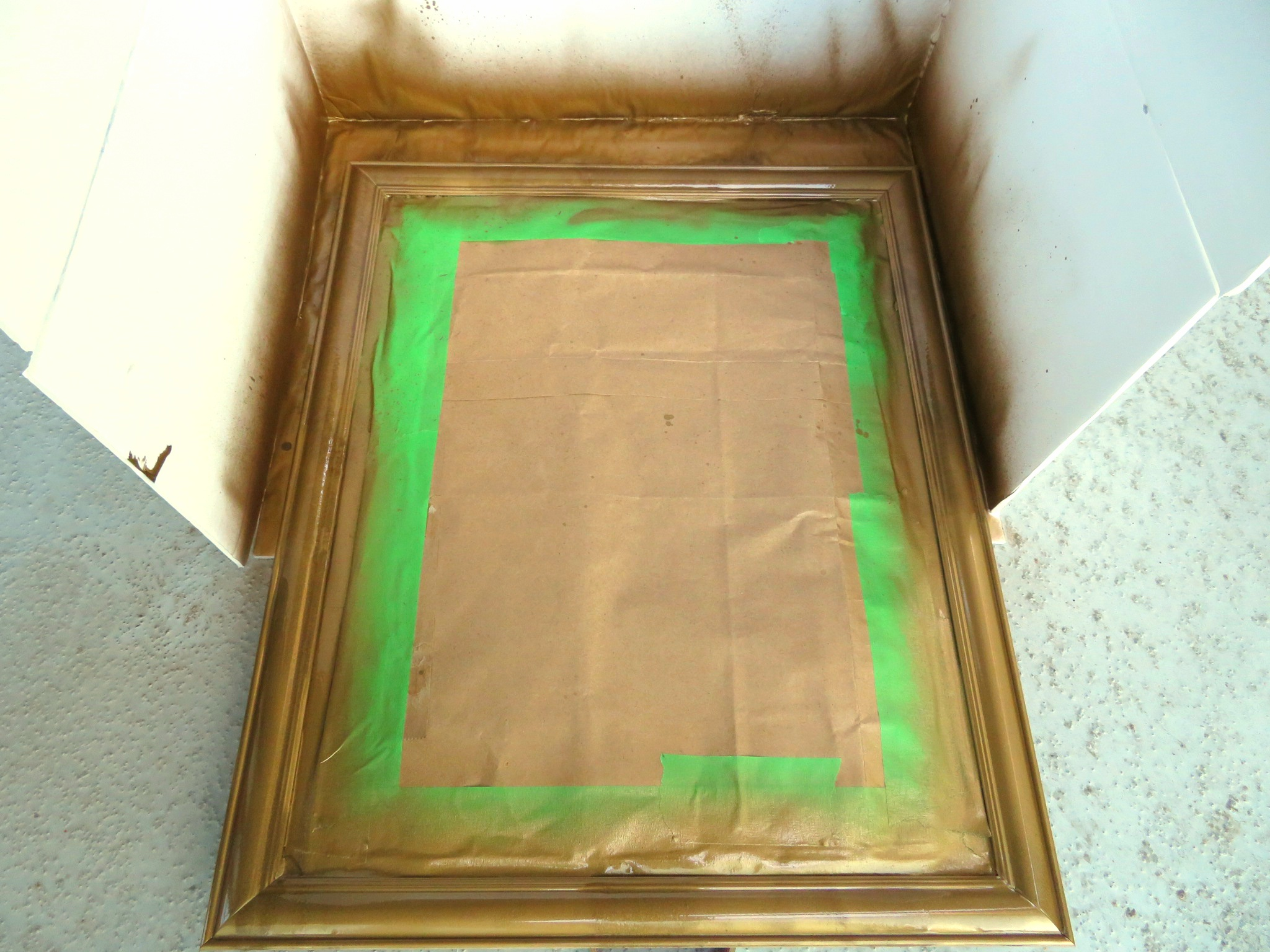 Gold spray painted mirror frame for DIY project