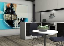 Abstract painting beside potted plant in a kitchen