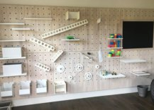 Activity-wall-in-the-kids-room-combines-storage-and-play-time-with-creativity-92551-217x155