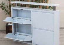 All-white cabinet with hidden shoe rack