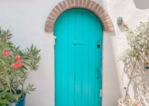 Arched blue door with number 24