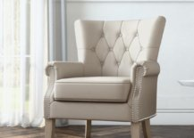 Beige chair with diamond tuft design and nail-head trim
