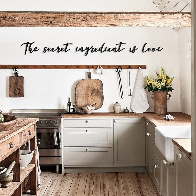 Black metal statement wall decal in white kitchen wall