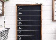 Blank weekly menu chalkboard on white brick wall