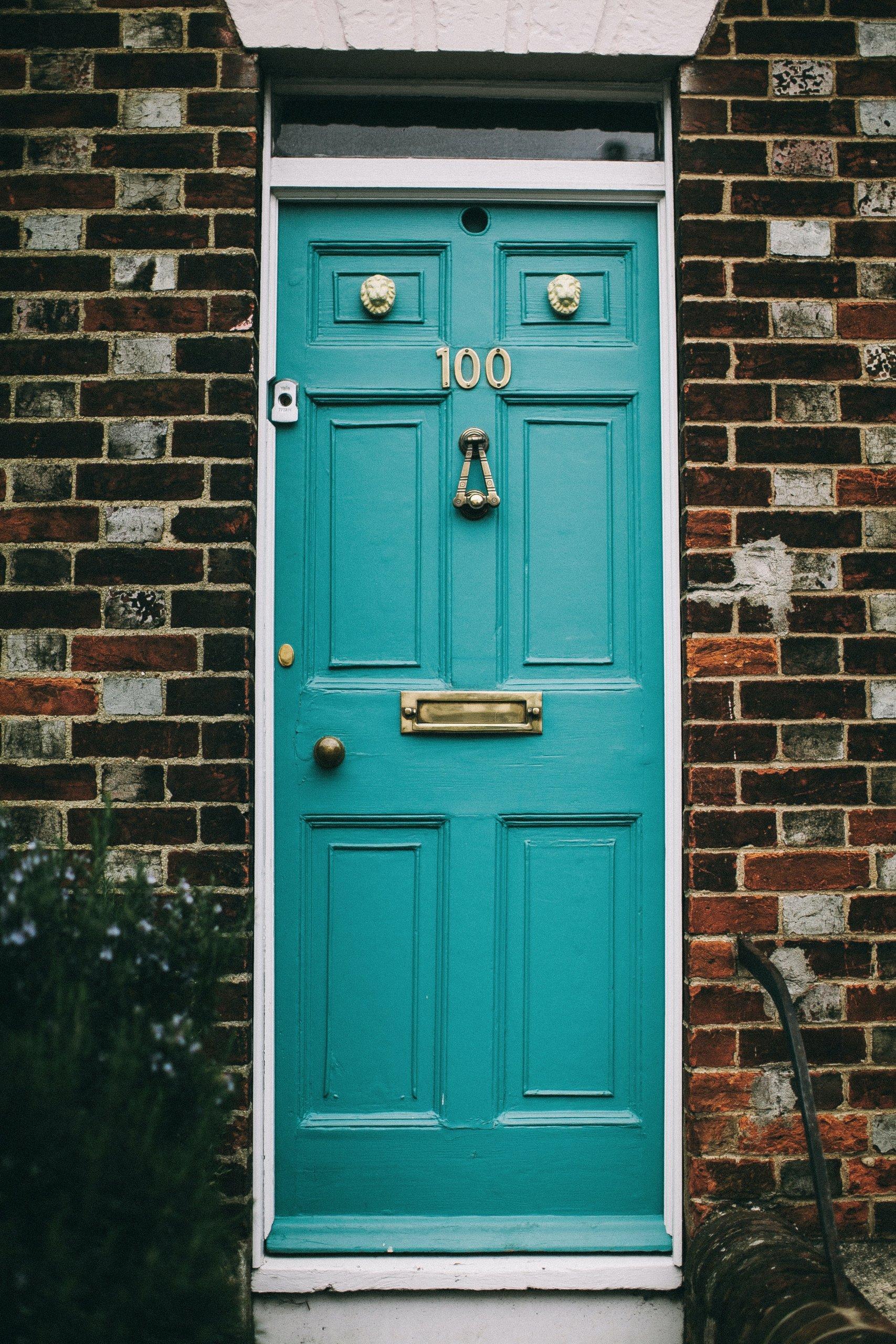 Blue door with door knob and mail slot
