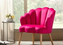 Bright pink chair in front of window