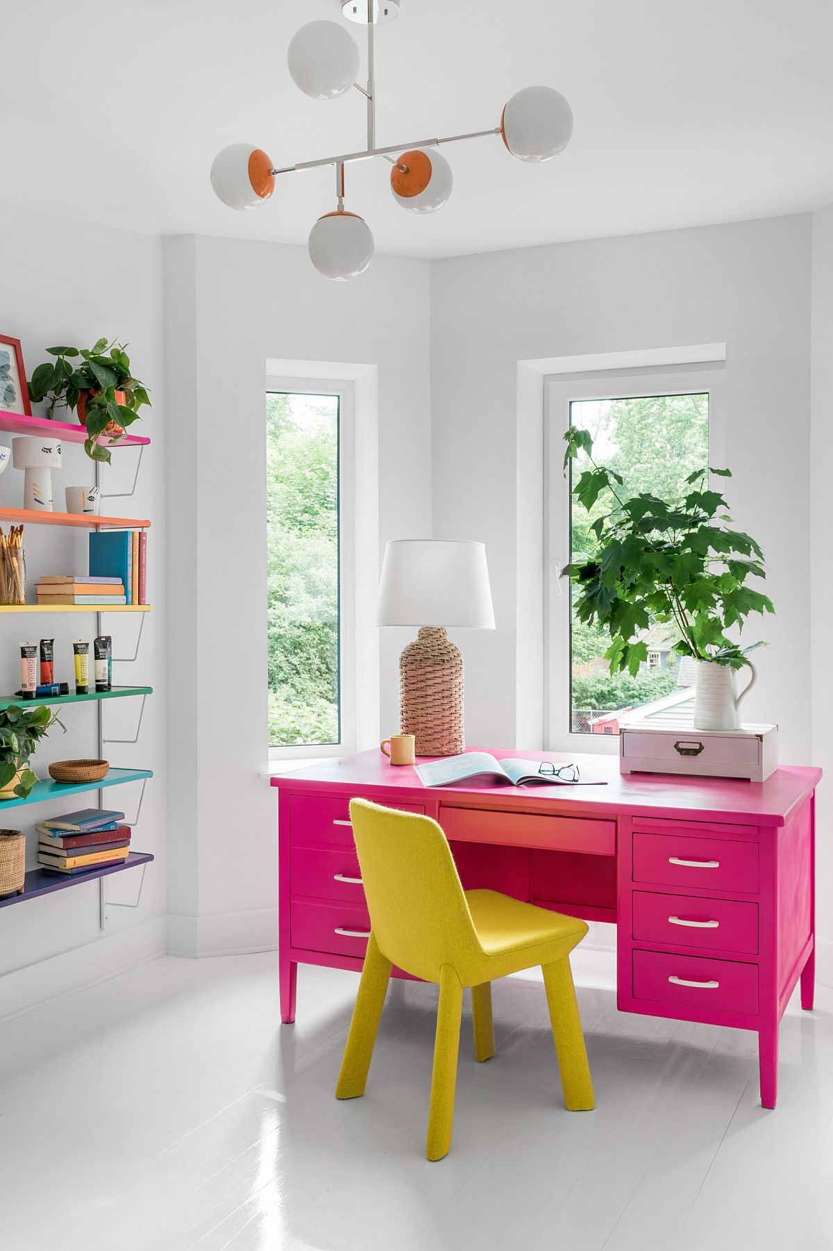 Brilliant hot pink desk and bright yellow chair steal the show in this contemporary home office