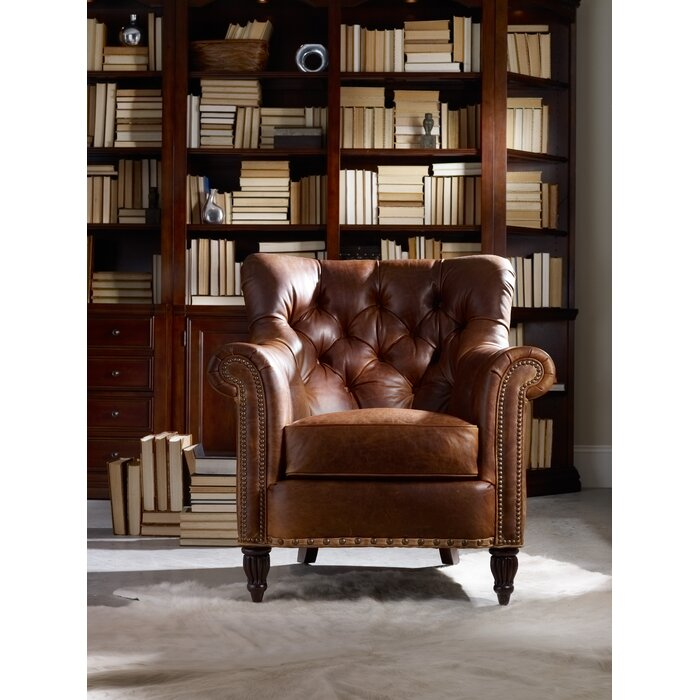 Brown armchair in front of shelves of books