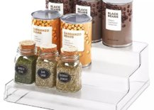 Canned beans and dry herbs on transparent rack