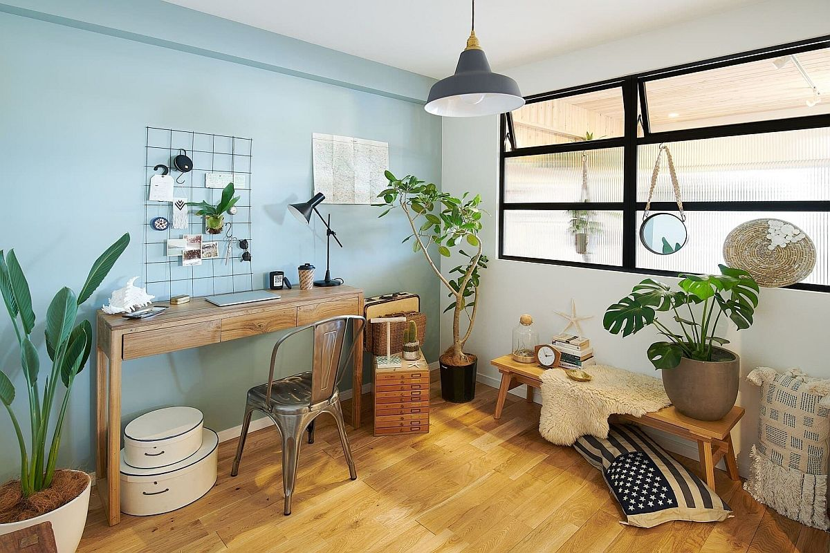 Chic coastal style home office in white and blue is a great place for indoor plants
