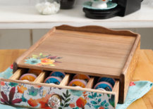 Coffee pods inside a painted wooden crate