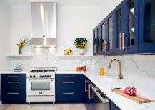 Contemporary-I-shaped-kitchen-with-navy-blue-cabinets-white-marble-backsplash-and-brass-fixtures-62086-217x155