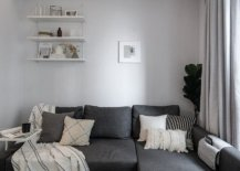 Cozy-sectional-in-gray-sits-snugly-in-the-corner-and-also-offers-additional-storage-space-51327-217x155