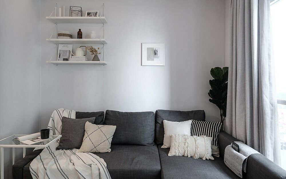 Cozy-sectional-in-gray-sits-snugly-in-the-corner-and-also-offers-additional-storage-space-51327