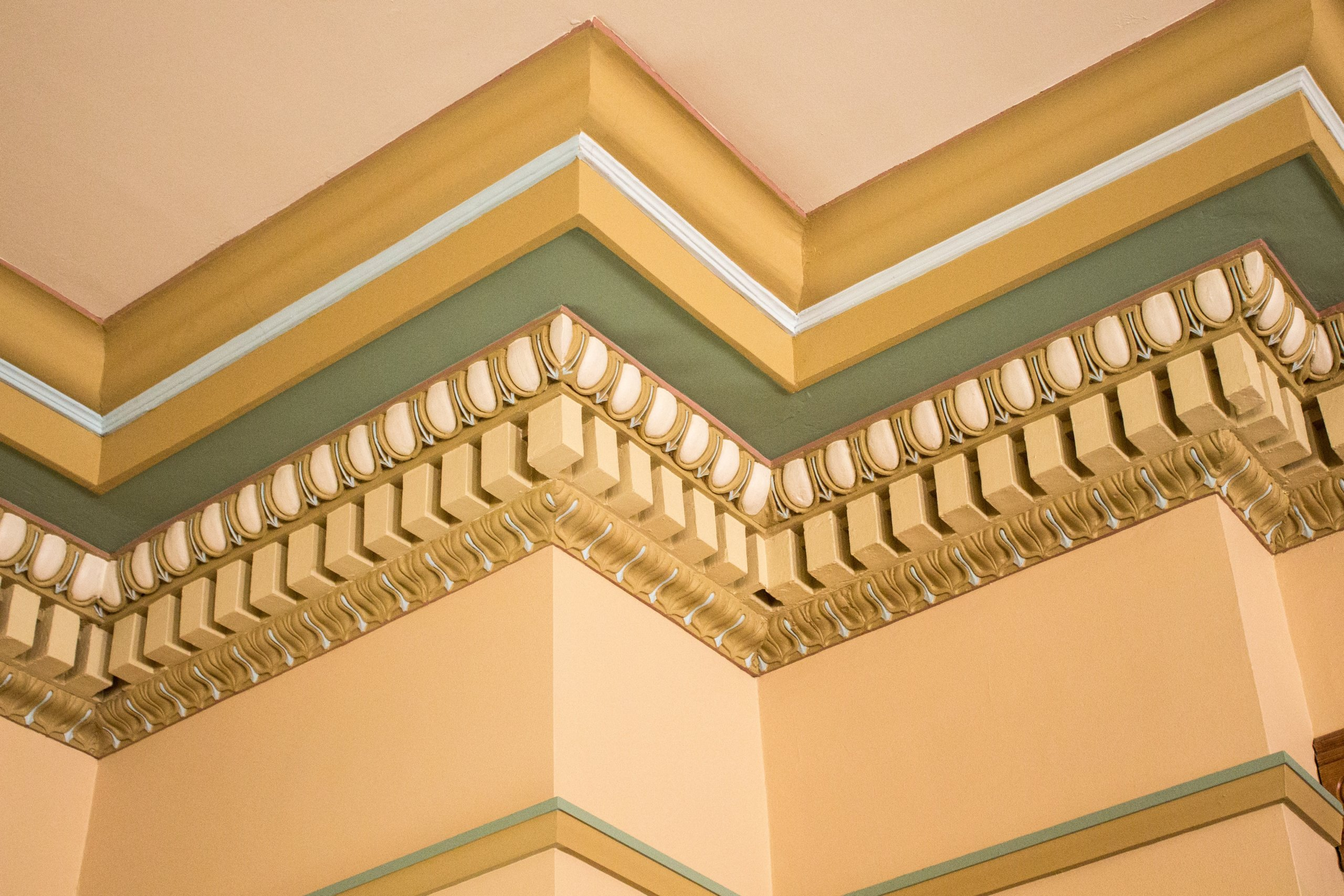 Crown molding with ornate woodwork