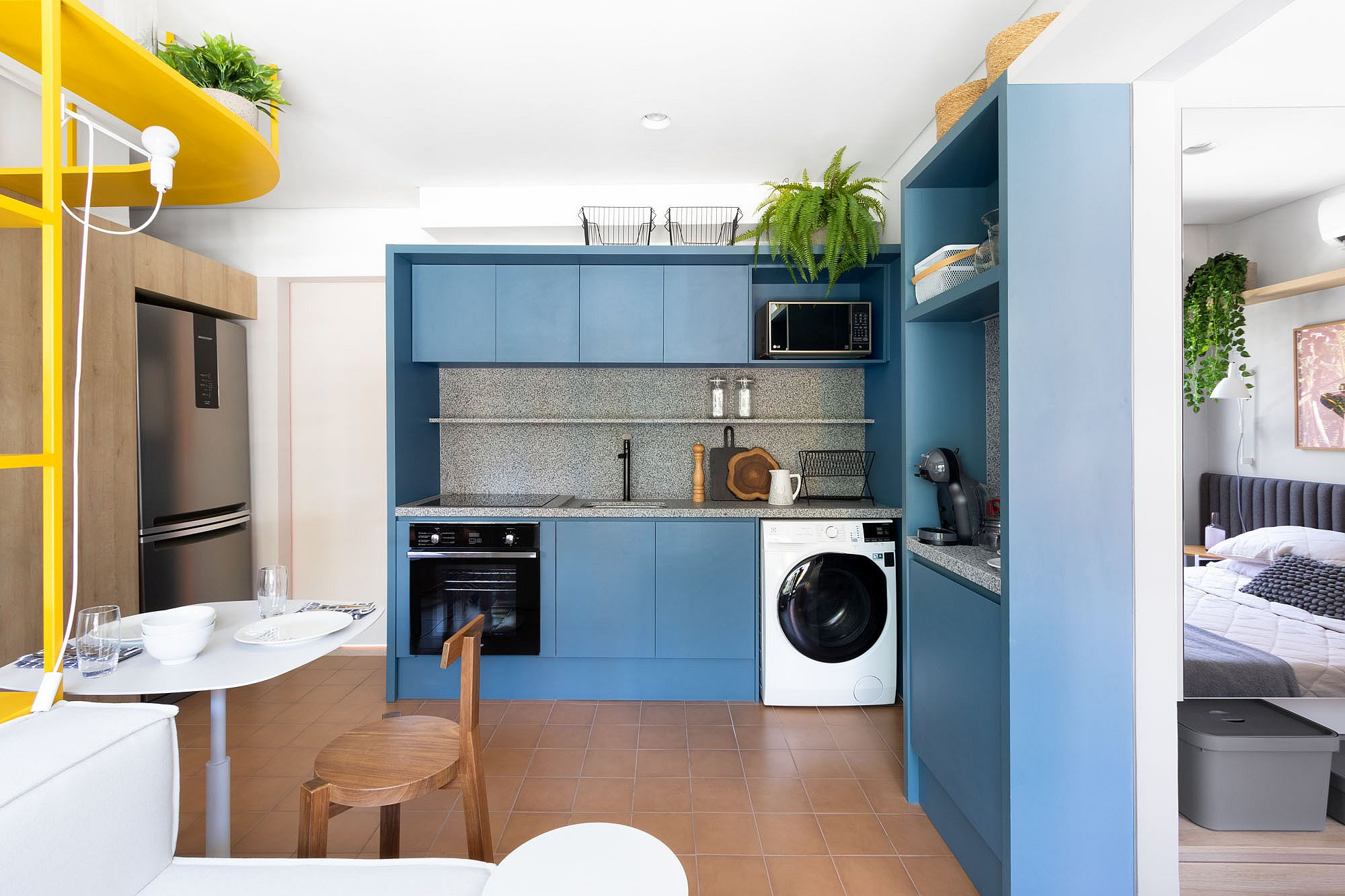 Custom blue cabinets combined with granite countertops in the space-savvy kitchen