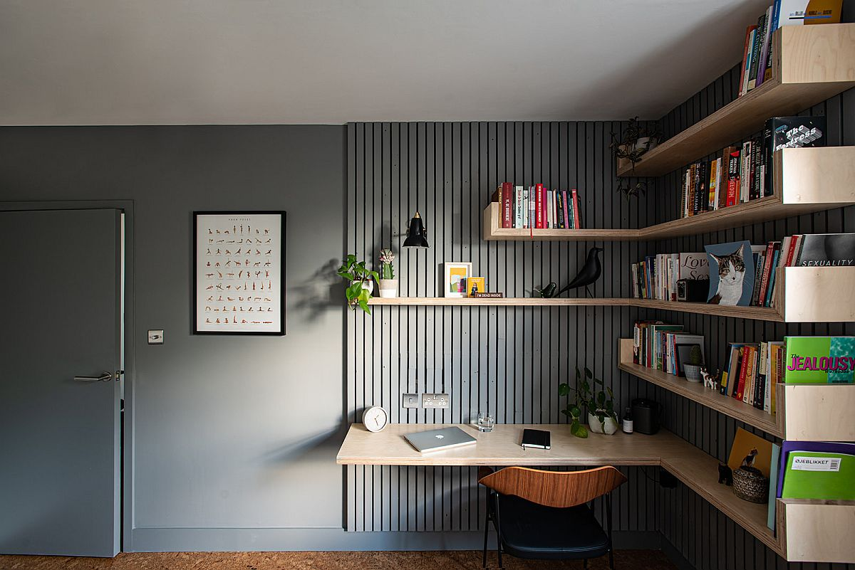 Custom floating shelves in wood along with the desk bring ergonomic ease to this home office