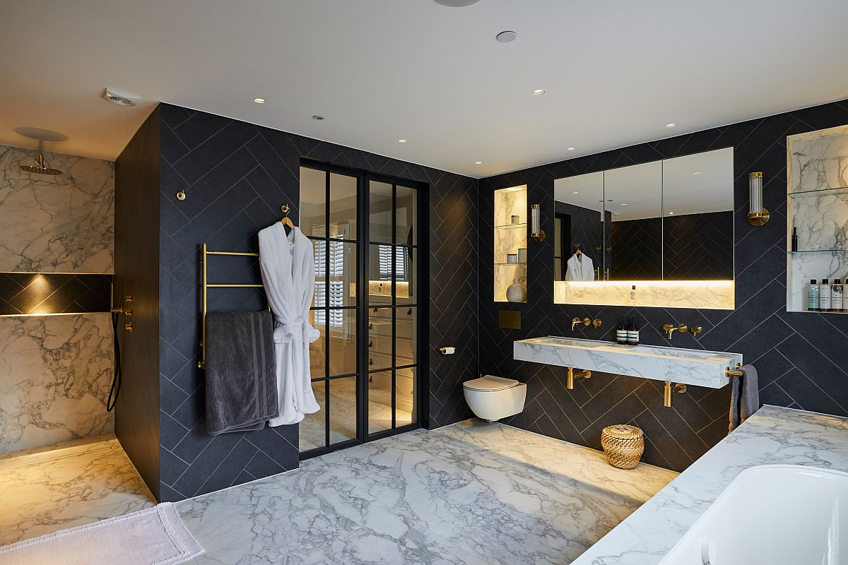 Dark-finishes-and-brass-fixtures-stand-in-contrast-to-the-polished-marble-surfaces-in-the-bathroom-56070