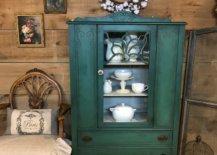 Dark green cabinet with white china