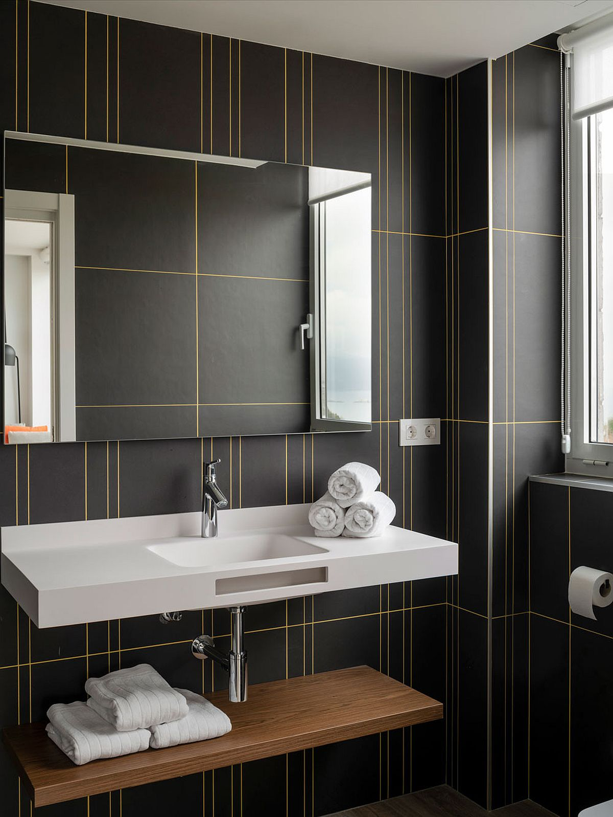 Dashing-use-of-yellow-lines-in-a-minimalist-manner-steal-the-show-in-this-dark-gray-bathroom-41026
