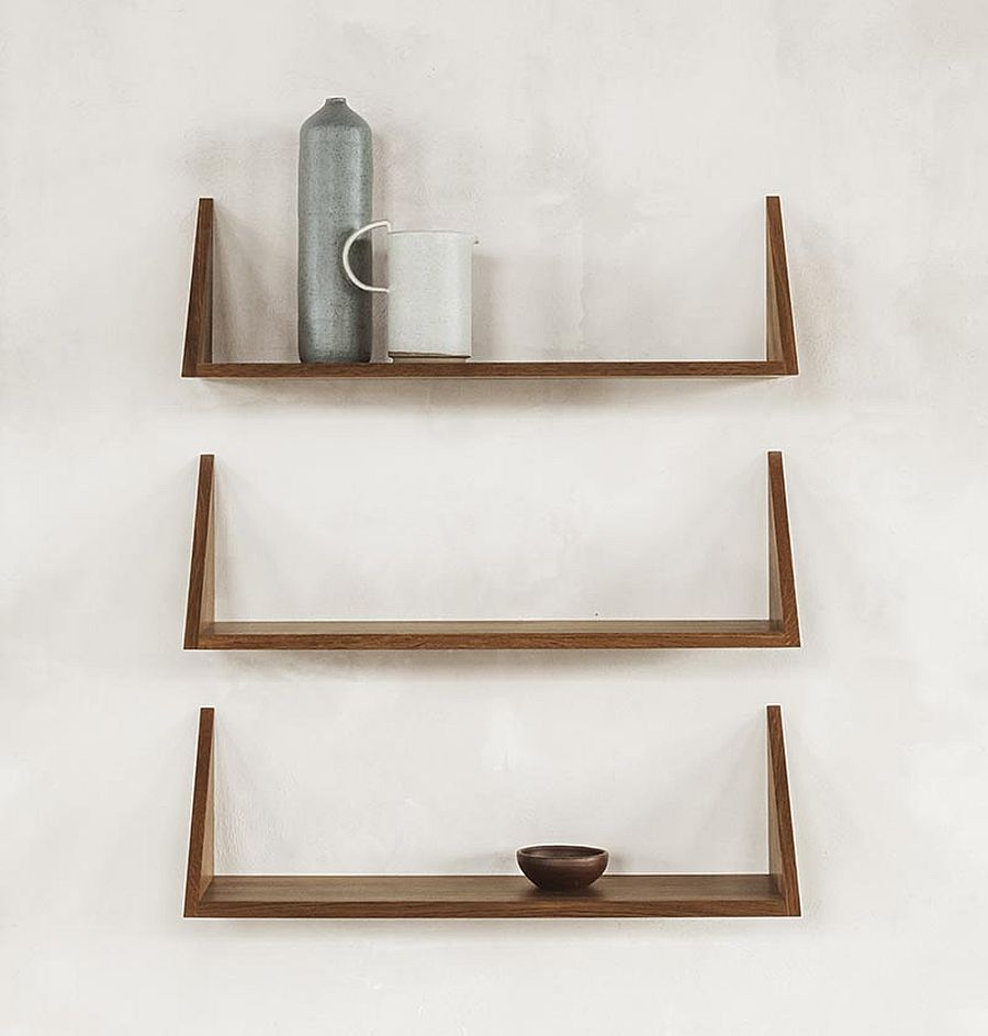 Different ways to decorate the slim oak wooden shelves next to the wall-mounted desk