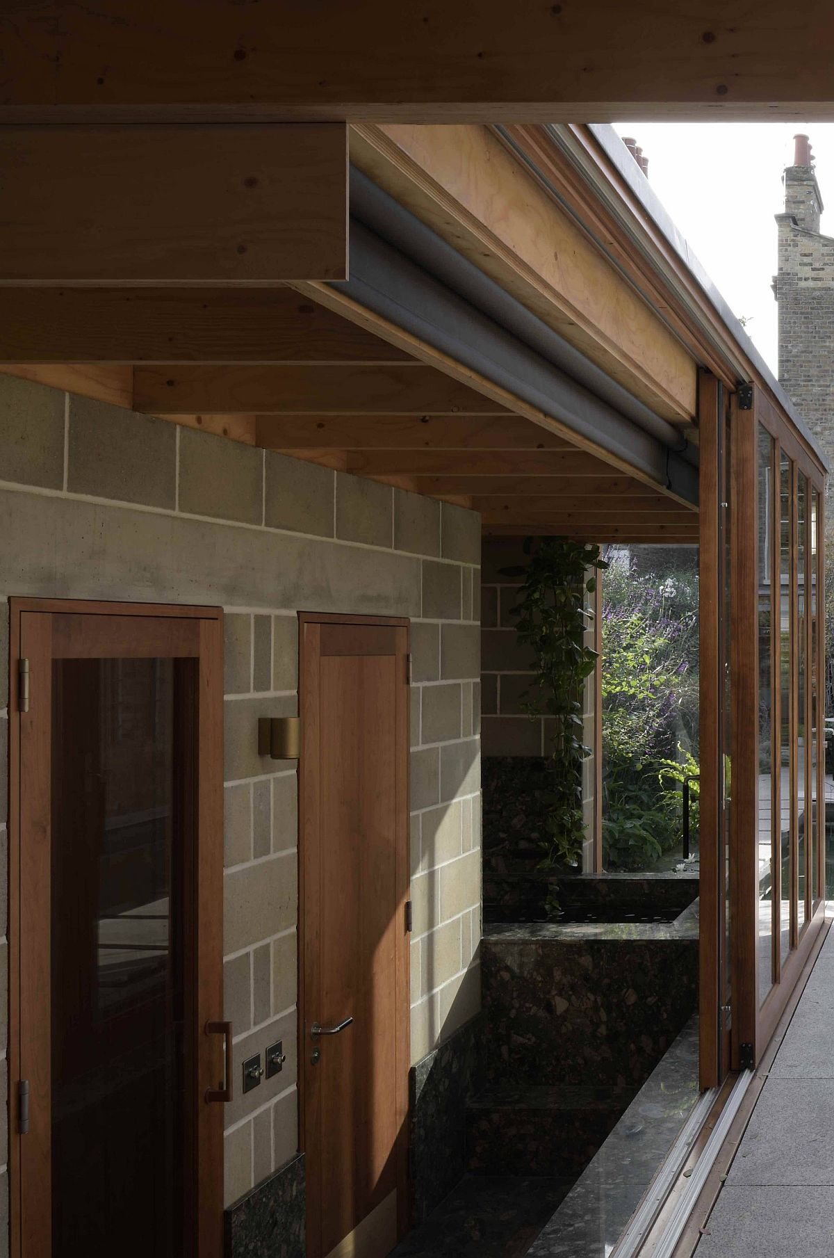 Engineered timber roof structure coupled with blockwork walls for the garden room