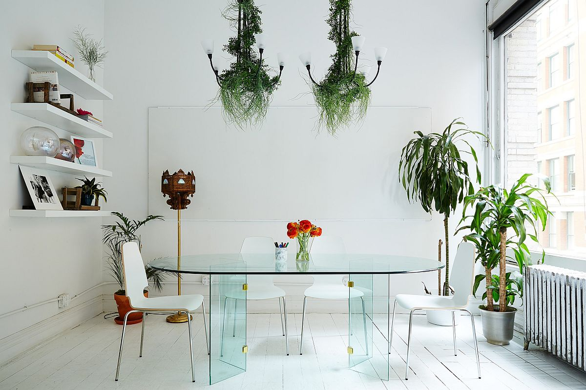 Exquisite New York dining room where greenery ushers in pops of color