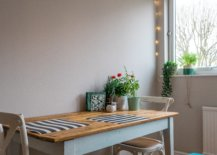 Flower vase on dining table with blue bench
