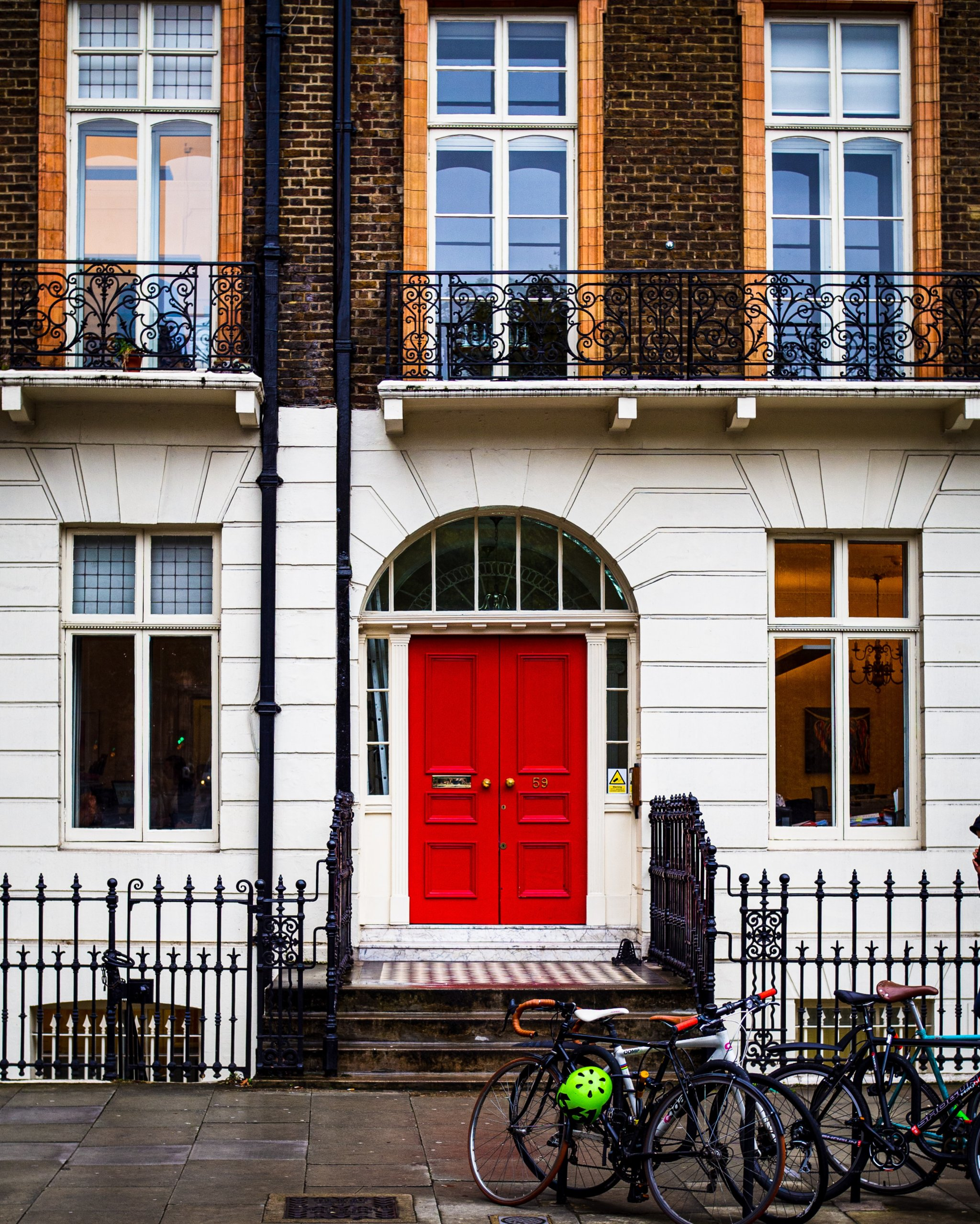 Front house with red door and bicycles