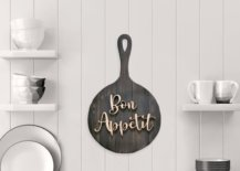 Frying pan kitchen wall decor in the middle of a white wall