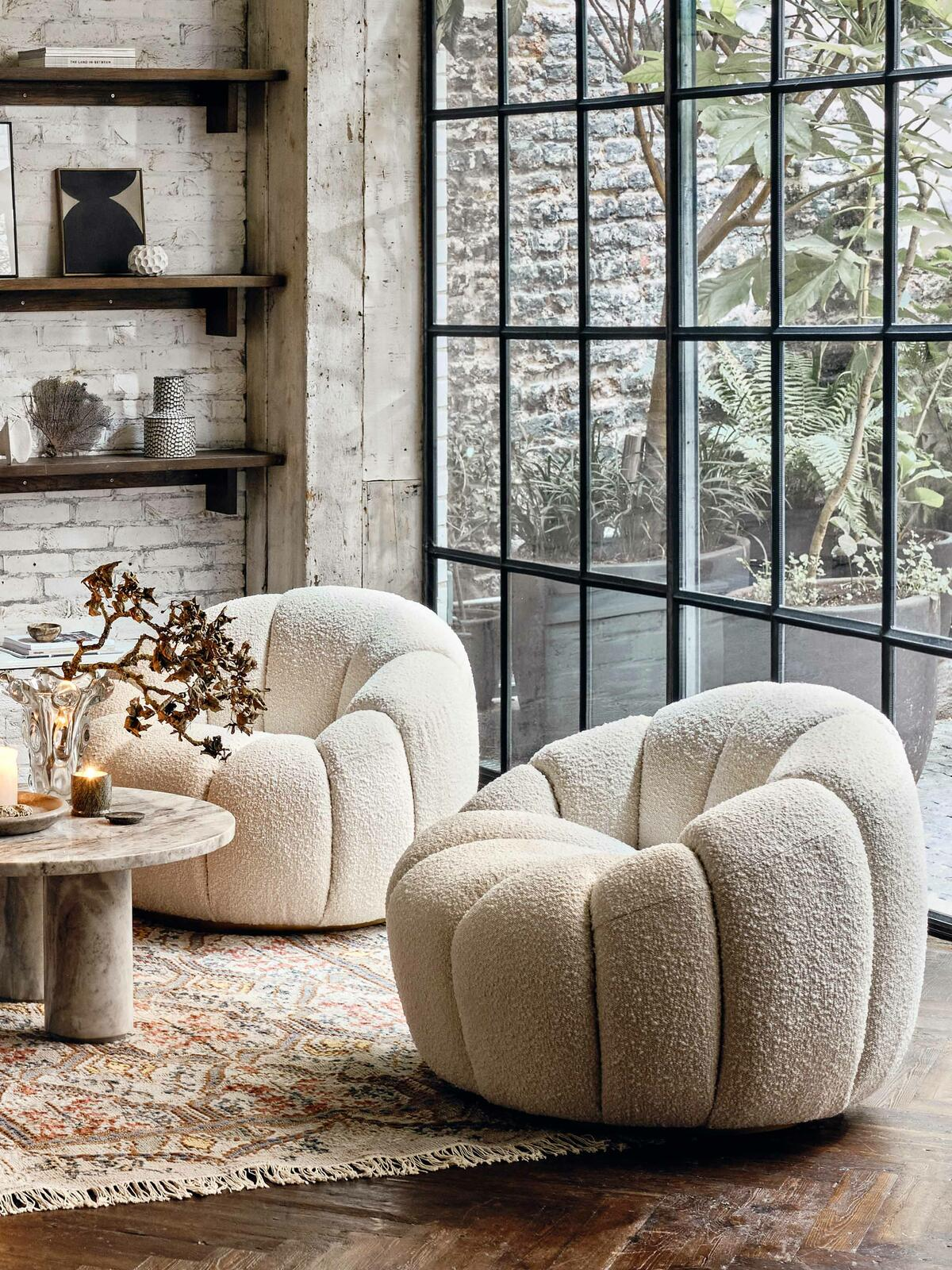 Fuzzy white round chair in beside window panels