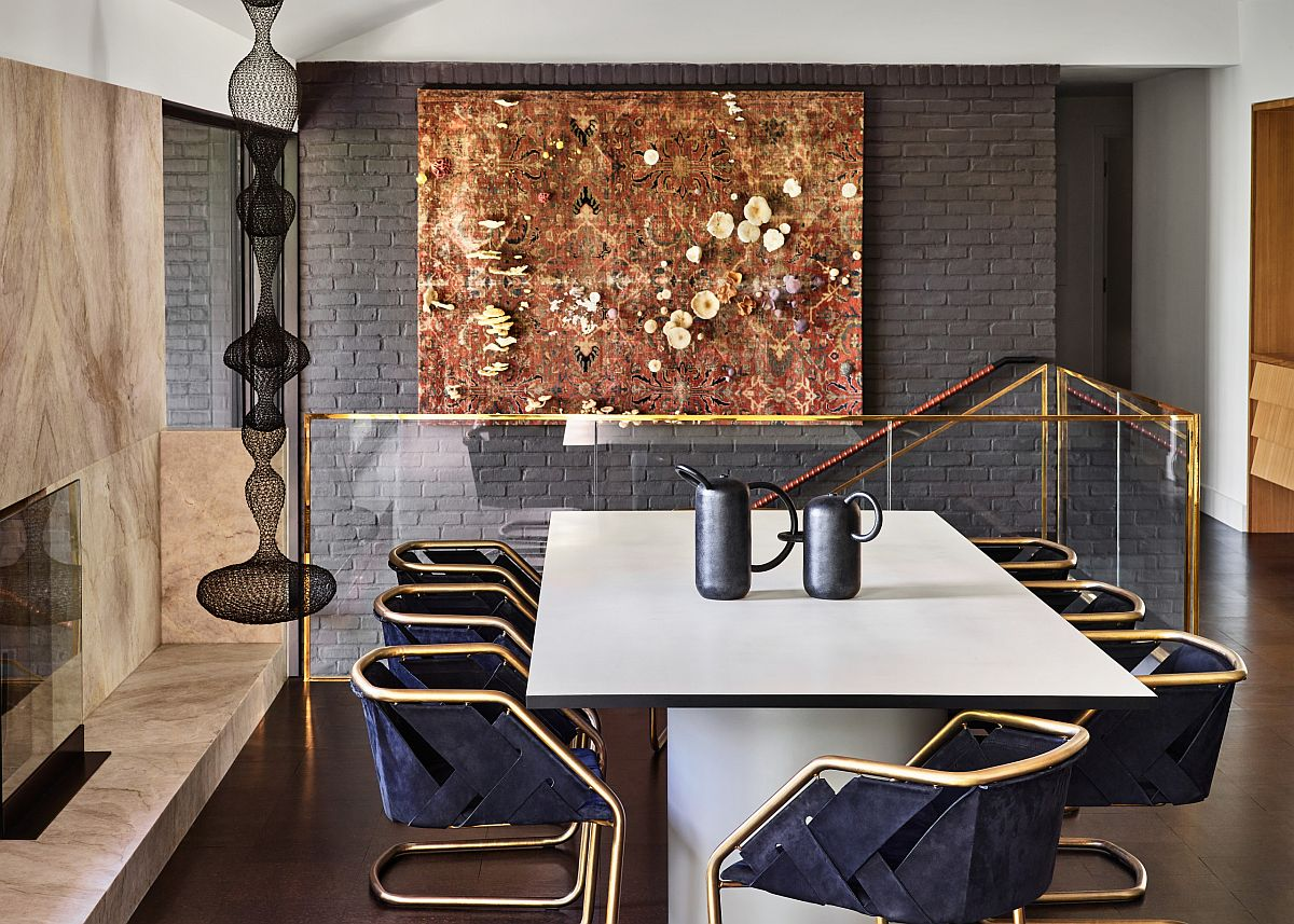 Gorgeous mid-century modern home office with golden glint and a gray, painted brick wall backdrop