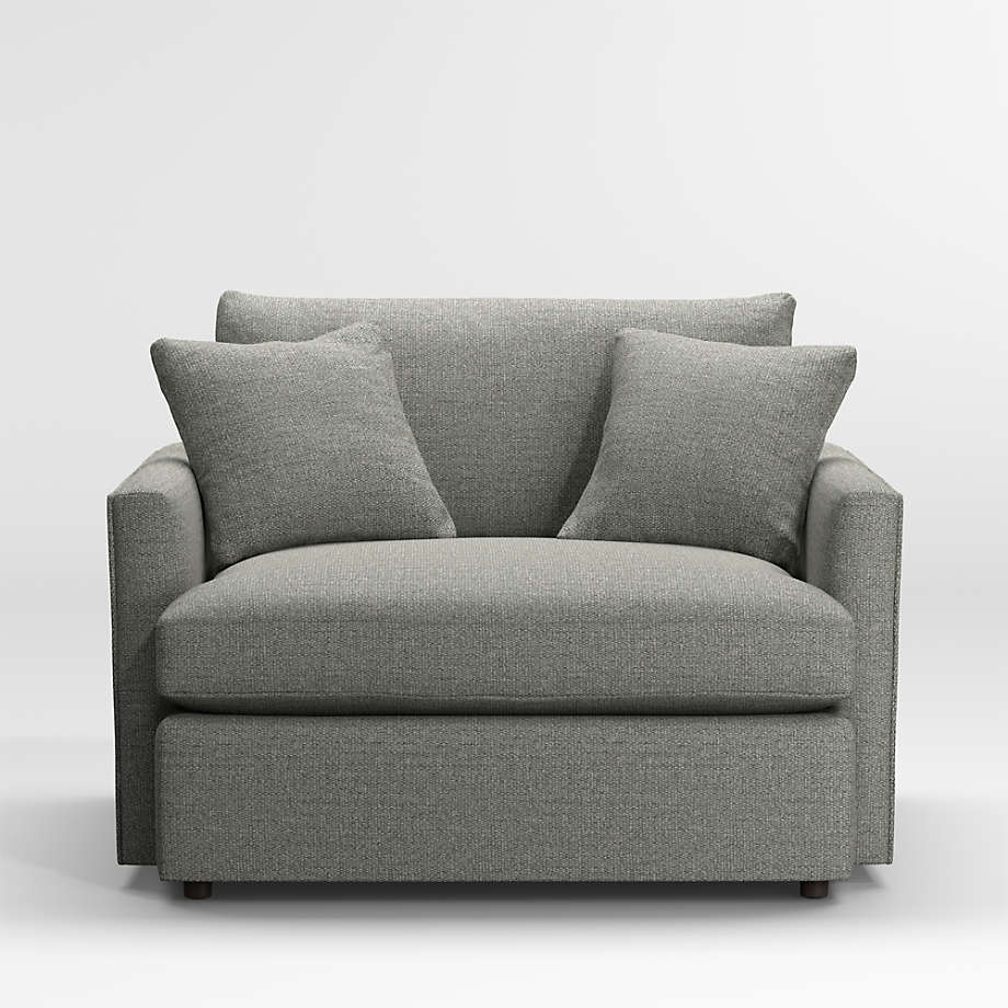 Grey lounge chair with two grey cushions