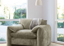 Grey oversized armchair with hanging light