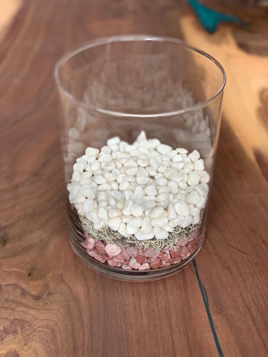 White river stones in vase