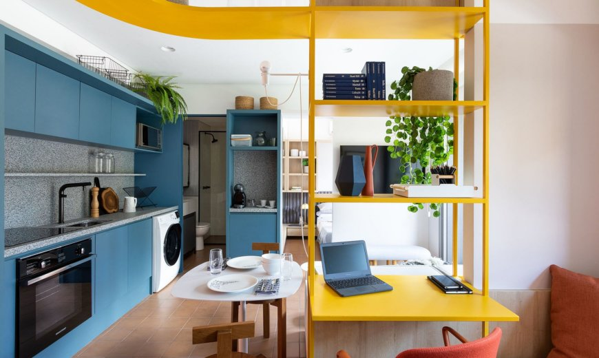 Vivid Splashes of Blue and Yellow Invigorate this Space-Savvy Brazilian Apartment