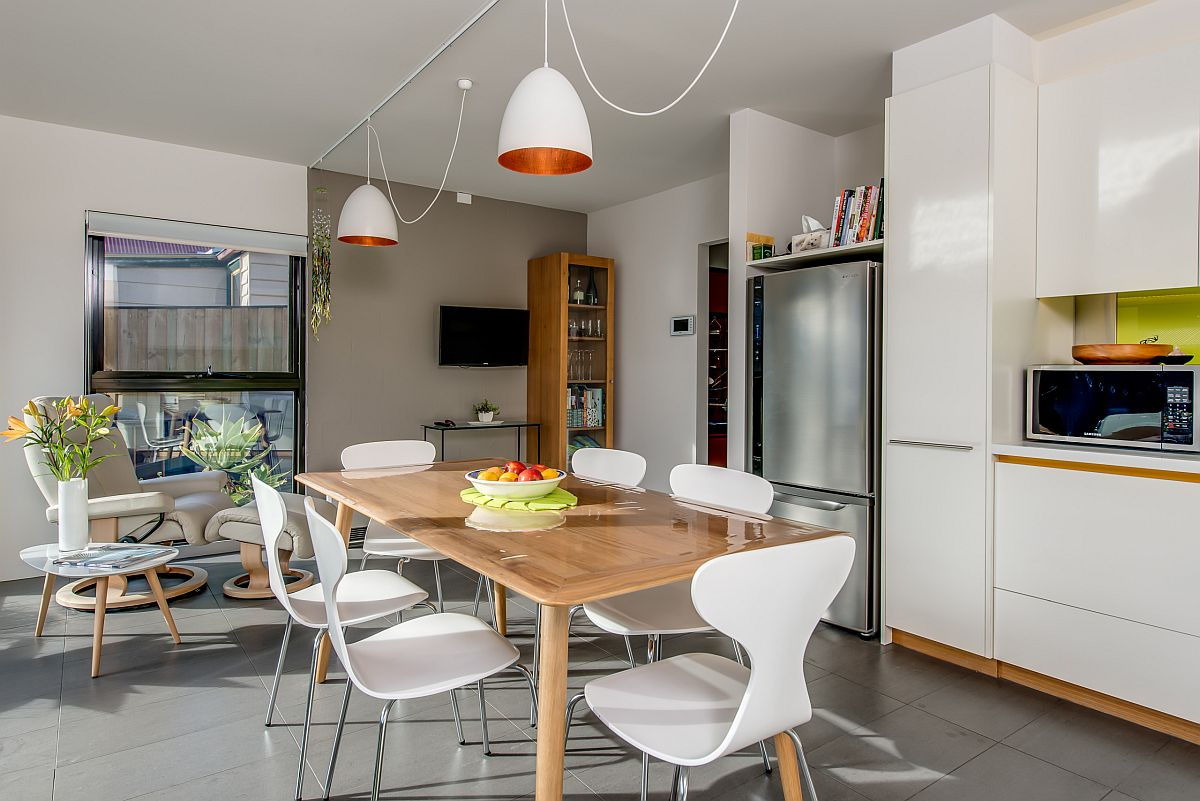 Kitchen and dining area have a common wood and white color scheme
