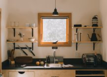Kitchen sink with square window and shelves
