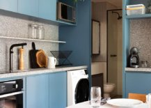 L-shaped-eat-in-kitchen-with-blue-cabinets-and-granite-countertops-39052-217x155