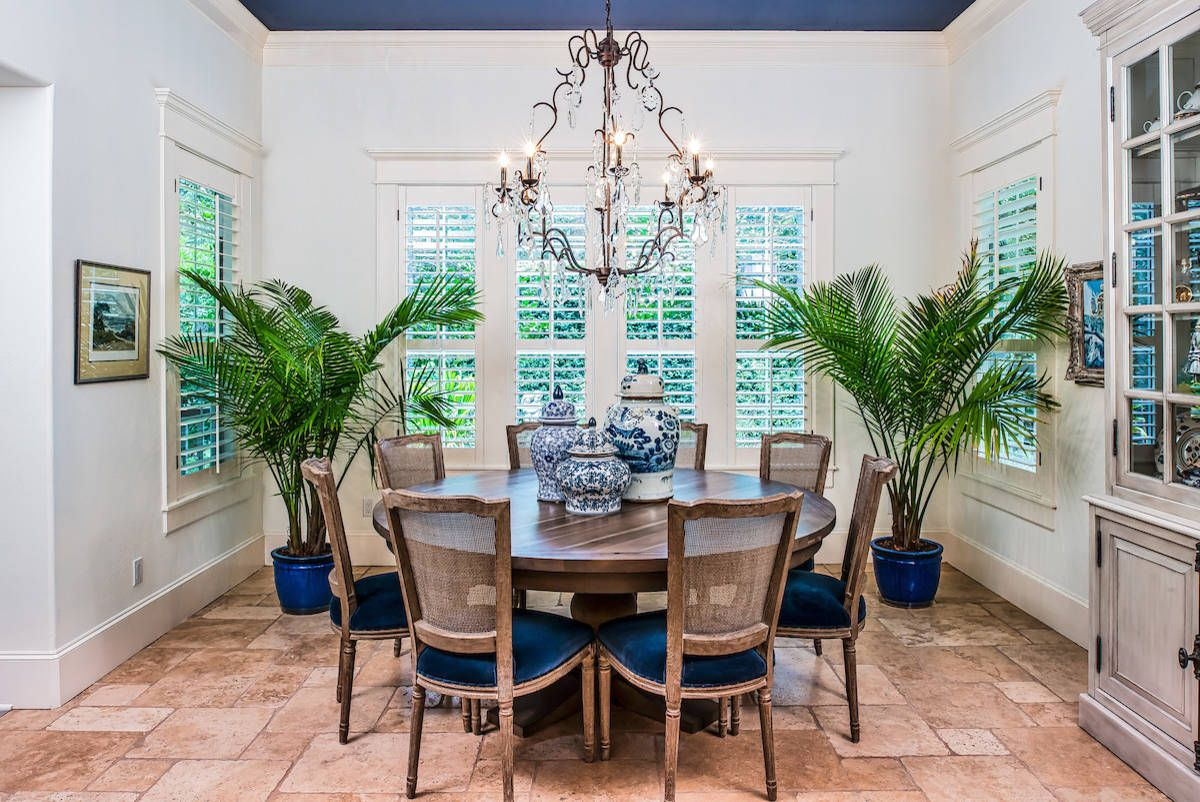 Large indoor plants in the dining room bring casual vibe to the space