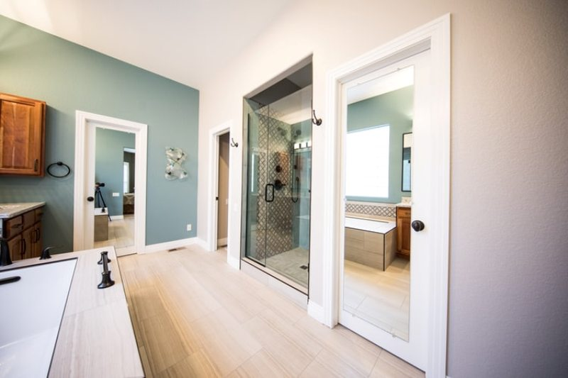 Light colored bathroom with shower stall and tub