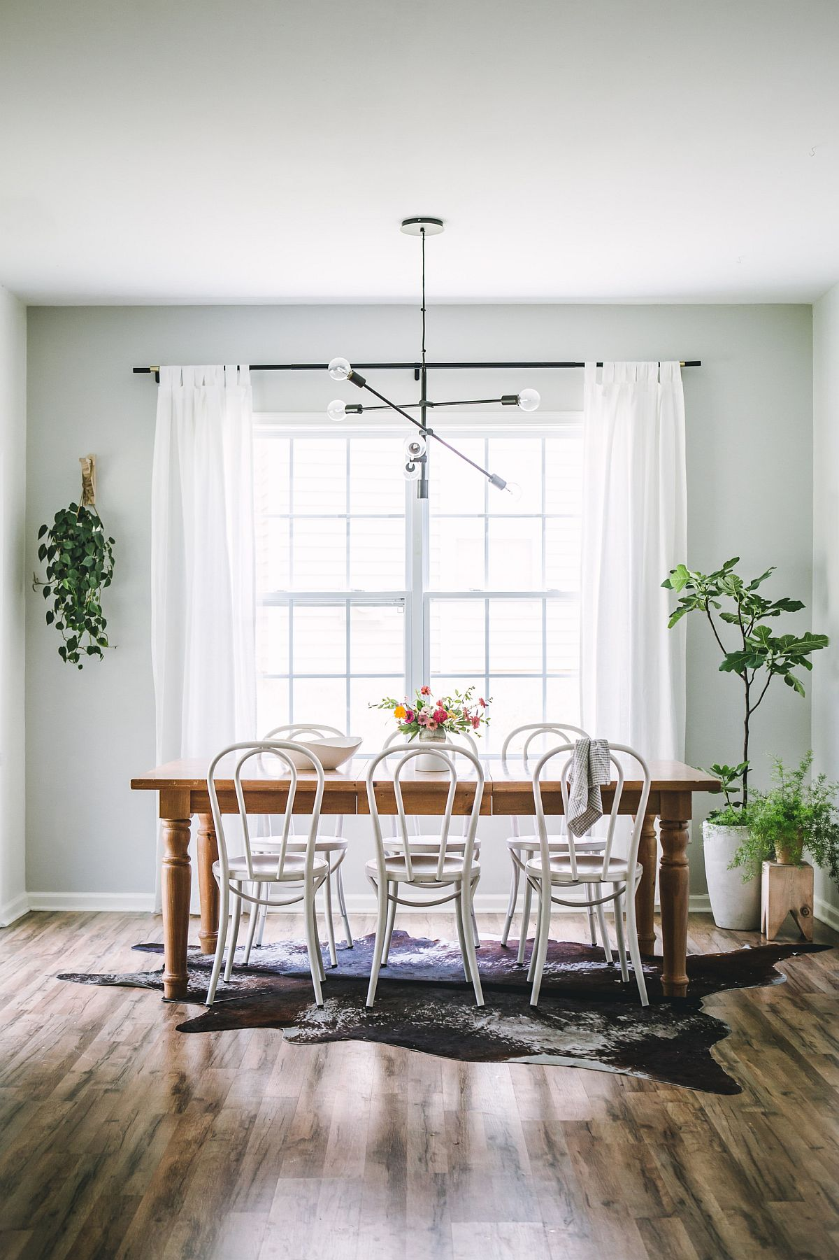 Light-gray in the dining room is as effective as white for a charming and stylish backdrop