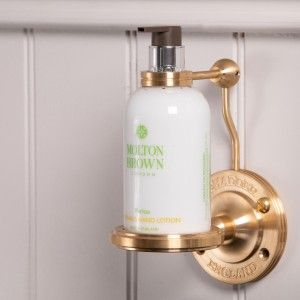 Lockable shower bottle holder