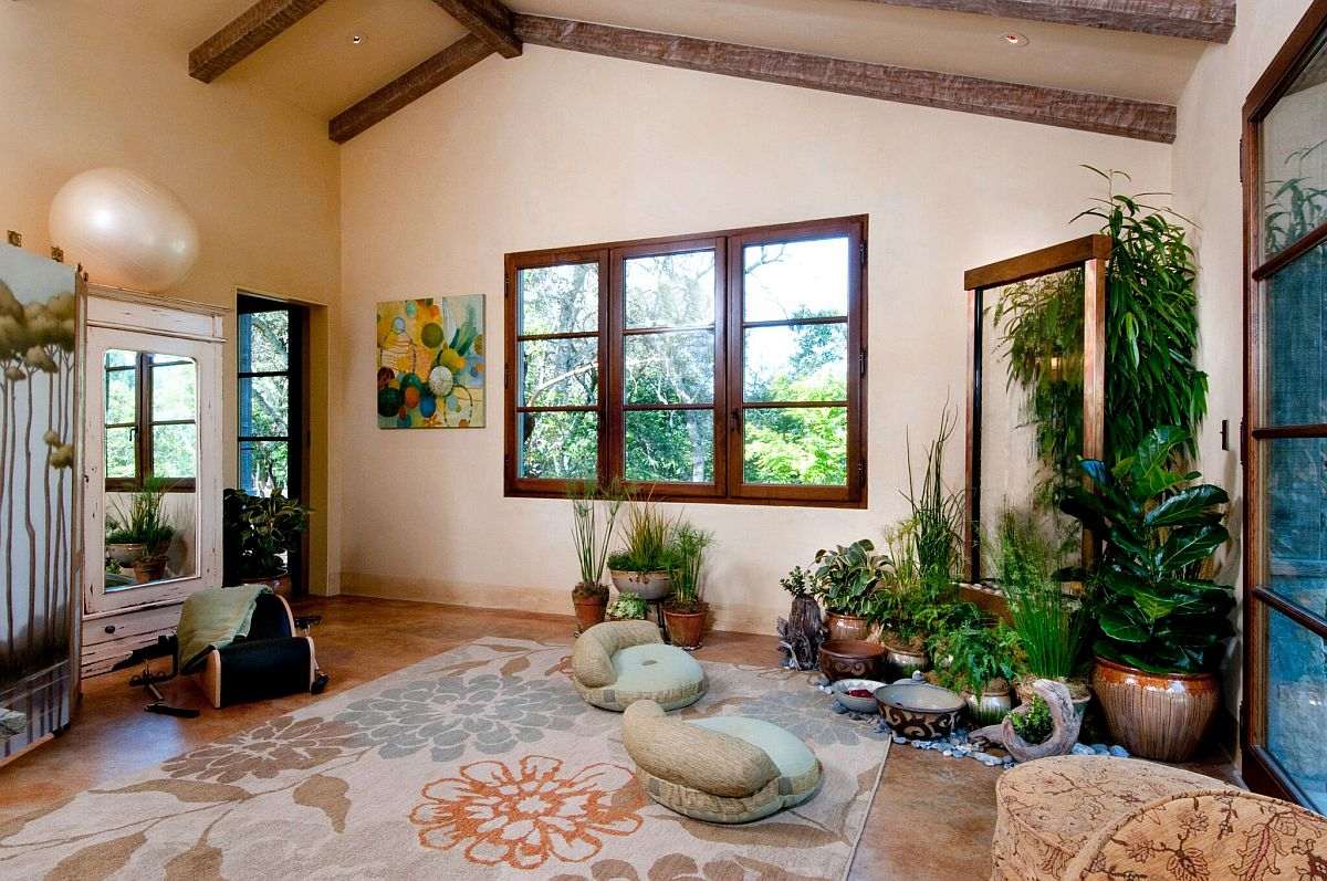 Lovely yoga and meditation room with a backdrop that helps you relax
