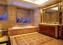 Luxurious bathroom with chandelier and big mirror
