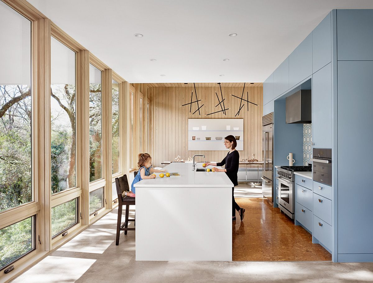 Midcentury-modern-kitchen-with-glass-walls-blue-cabinets-and-a-smart-central-island-37437