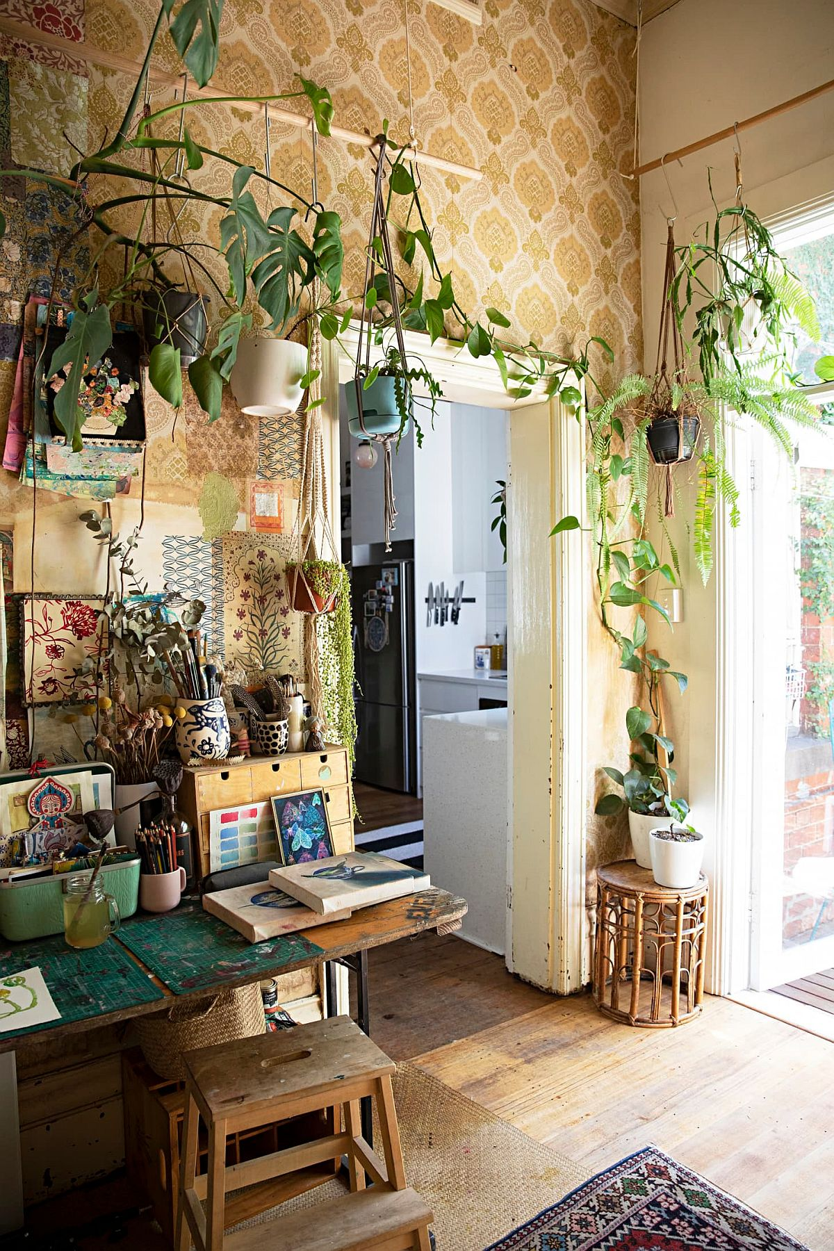 Modern eclectic home office in Melbourne with a creeper that adds greenery to the room