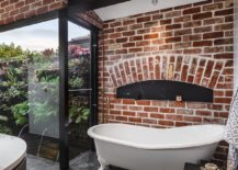 Modern-industrial-bathroom-with-a-brick-wall-backdrop-and-lovely-black-accents-55783-217x155