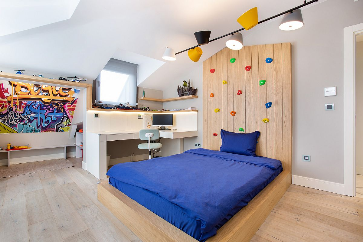 Modern kids' bedroom with compact study zone, climbing wall and a relaxing ambiance in neutral hues